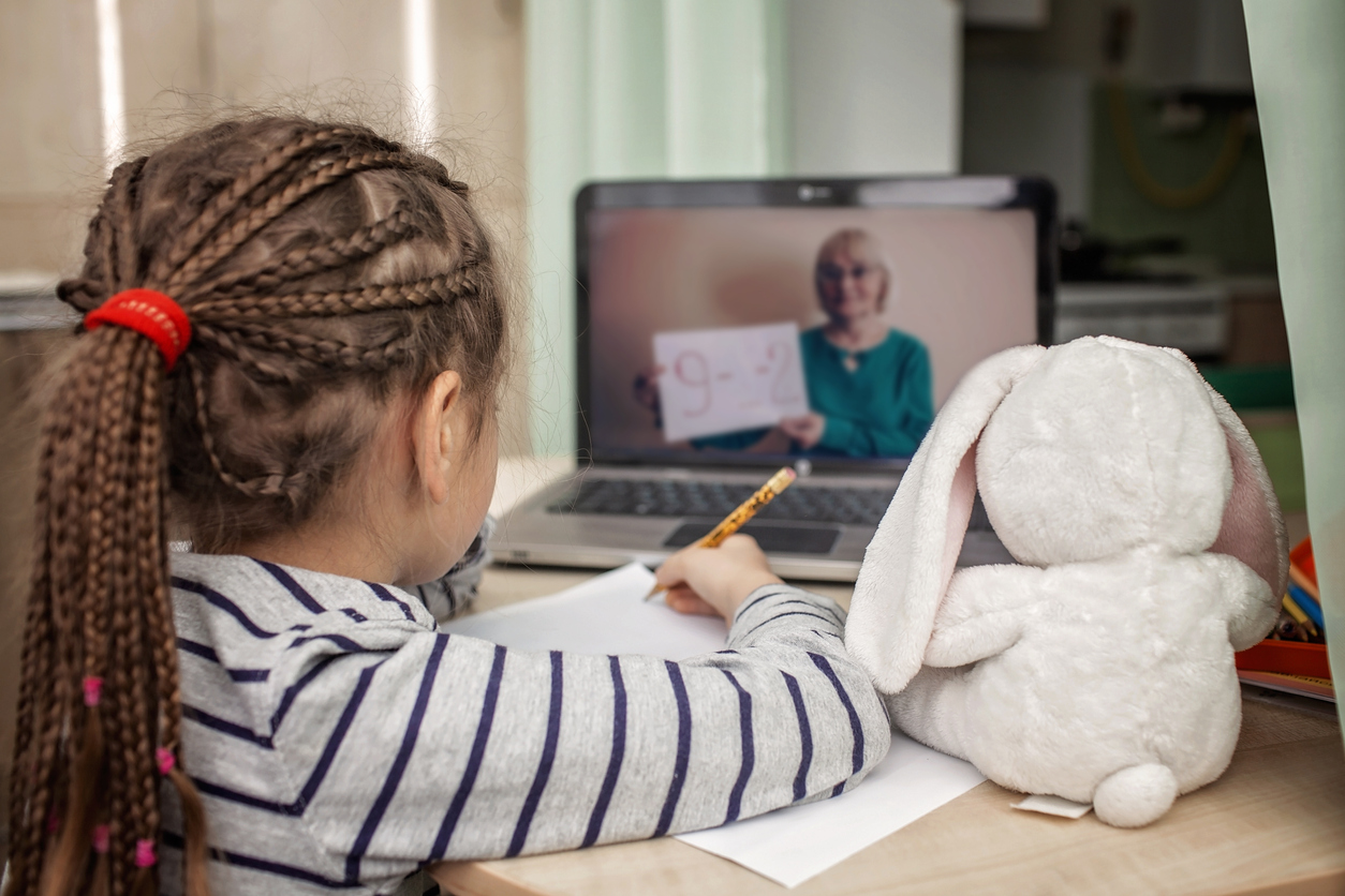 Pretty stylish schoolgirl studying math during her online lesson at home, social distance during quarantine, highlighting Five Back-To-School Health Tips During the Coronavirus Pandemic.