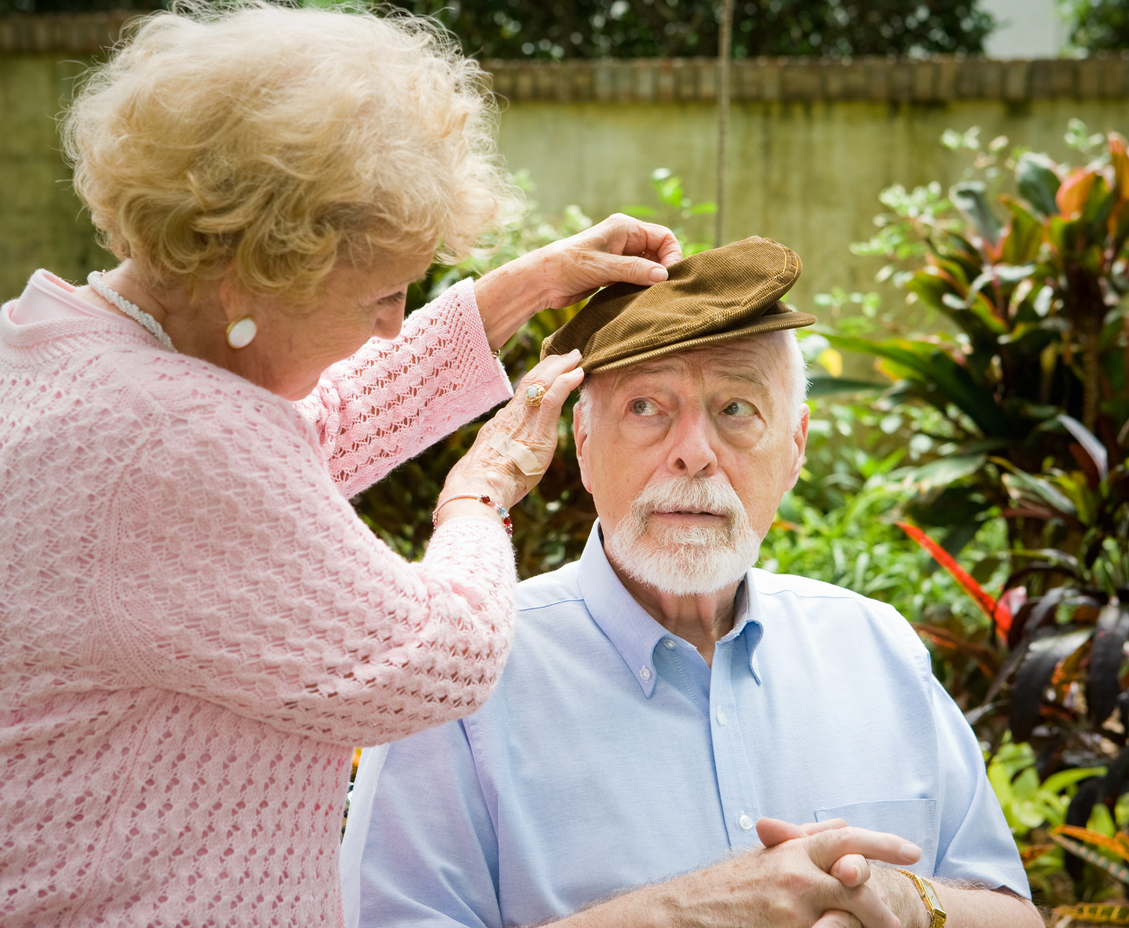 Loving wife cares for her elderly husband with alzheimers disease, knowing the early warning signs of Alzheimer's disease.